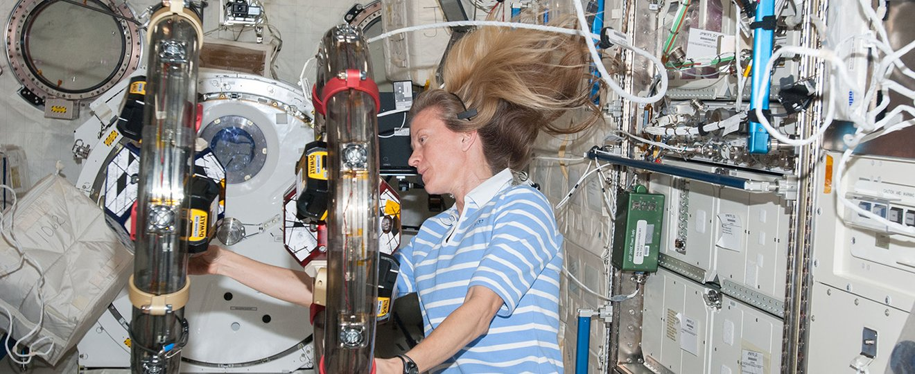 An astronaut getting to grips with space disorientation on the international space station.