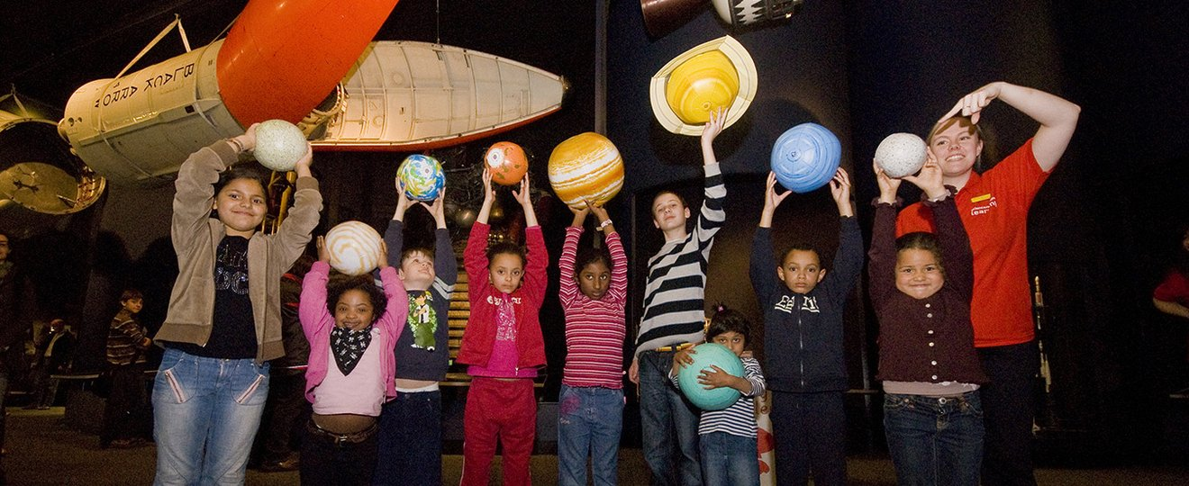 Children learning about space in science centre.