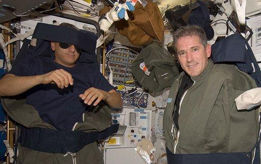 Astronauts sleeping in space.