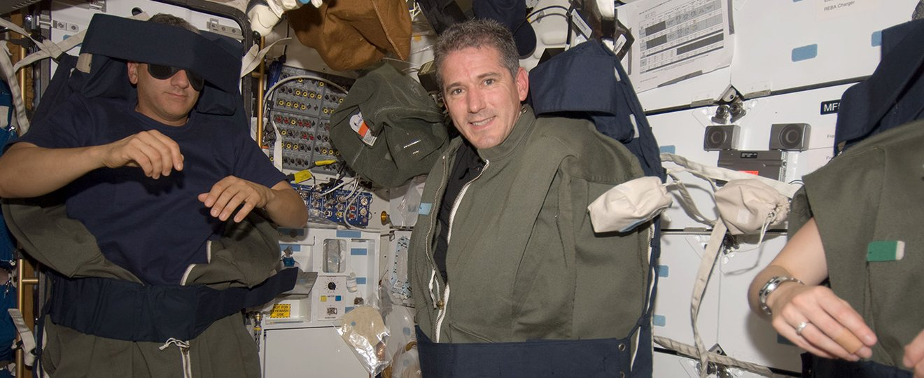 Astronauts sleeping in space on the international space station.